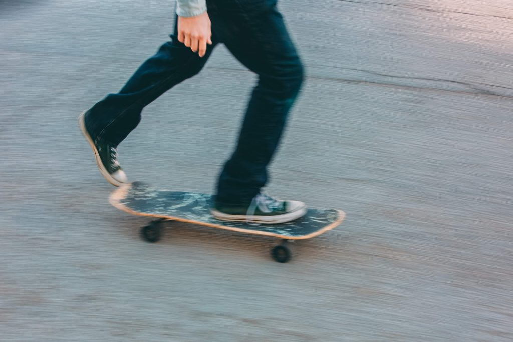 The guy riding his skateboard on the street | McLeish Orlando Personal Injury Lawyer Toronto